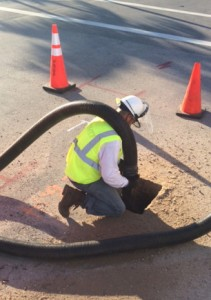 Our field employee digging a utility pothole using Air Vacuum excavation method.